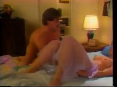 Vintage porn with this brunette sucking and fucking in a Motel